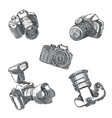 a set slr cameras in different positions are vector image