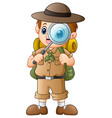 boy explorer with magnifying glass vector image