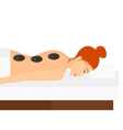 Woman getting stone therapy vector image