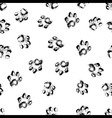Paw grunge footprint of dog or cat seamless vector image vector image