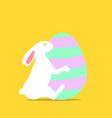 easter bunny hugging easter egg vector image