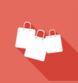 shopping bags on long shadow vector image vector image