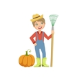 Boy Dressed As Farmer With Pumpkin And Rake