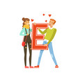 happy couple in love holding red letter e vector image vector image