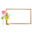 A fairy holding a flower in front of the empty vector image vector image