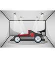 A black luxury car inside a garage vector image vector image