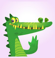 cute cartoon crocodile or dinosaur vector image