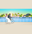 just married man woman riding bicycle romantic vector image vector image
