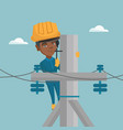african electrician working on electric power pole vector image vector image