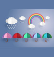colorful umbrella in the rain with rainbow vector image vector image