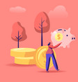 woman with piggy bank in hands stand near golden vector image vector image
