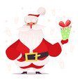 santa claus holding a gift vector image vector image
