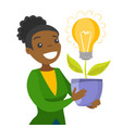 a businesswoman with a lightbulb as a symbol of vector image