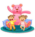 scene with two baby girls and giant teddy bear
