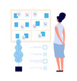 task board manager woman looking at planning vector image vector image