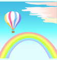 airballoon with colorful stripes in sky rainbow vector image