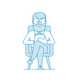 smiling man sitting in a chair and looking at a vector image