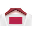 white blouse and empty tag on the collar wooden vector image