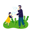 father blowing soap bubbles with daughter outdoor vector image