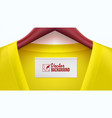 yellow clothes and empty tag on the collar wooden vector image vector image