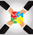 folded puzzles in the hands 4 hands vector image vector image