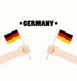 germany national day with hands holding up vector image vector image