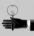 hand in black glove with an old magnifying glass vector image