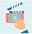 video play clapperboard hand vector image vector image