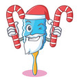 Santa with candy feather duster character cartoon vector image