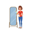 young brunette woman cleaning mirror using cleaner vector image