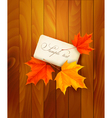 Card with leaves on wooden background vector image