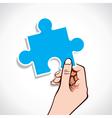 puzzle piece in hand vector image vector image