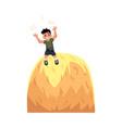 happy teen boy sitting on top of hay stack vector image