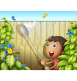 A butterfly catcher inside a yard with fence vector image vector image