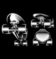 set three white skateboards on black background vector image vector image