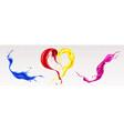splashes liquid paints in heart shape vector image