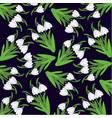 pattern from snowdrops on a dark blue background vector image vector image