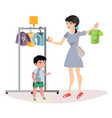 woman chooses clothes for her son vector image