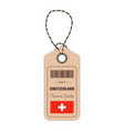 hang tag made in switzerland with flag icon vector image