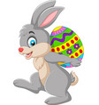 cartoon rabbit carrying an easter egg vector image vector image
