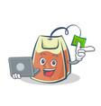 tea bag character cartoon with laptop vector image vector image