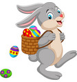 cartoon easter bunny carrying basket of an easter vector image vector image