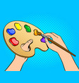 palette with paints in artist hands pop art vector image