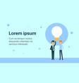 two business man partners holding light bulb vector image