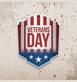 veterans day emblem on grunge background vector image