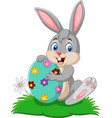 cartoon bunny holding easter egg vector image vector image