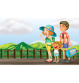 A happy family at the wooden bridge vector image vector image