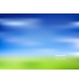 Blurry green field and blue sky vector image