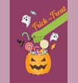 green zombie hand holding halloween pumpkin vector image