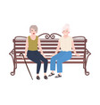 pair of smiling elderly women sitting on bench and vector image